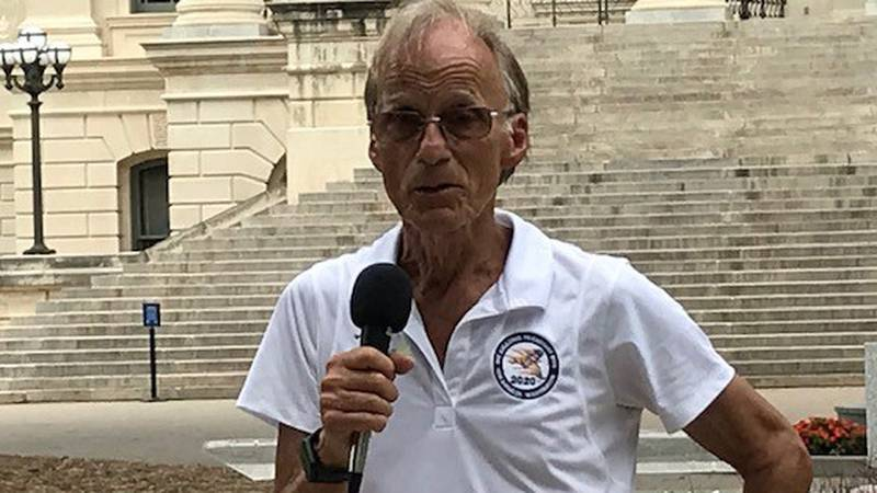 78-year-old Stan Cottrell stopped in Topeka on Thursday, as he runs cross country.