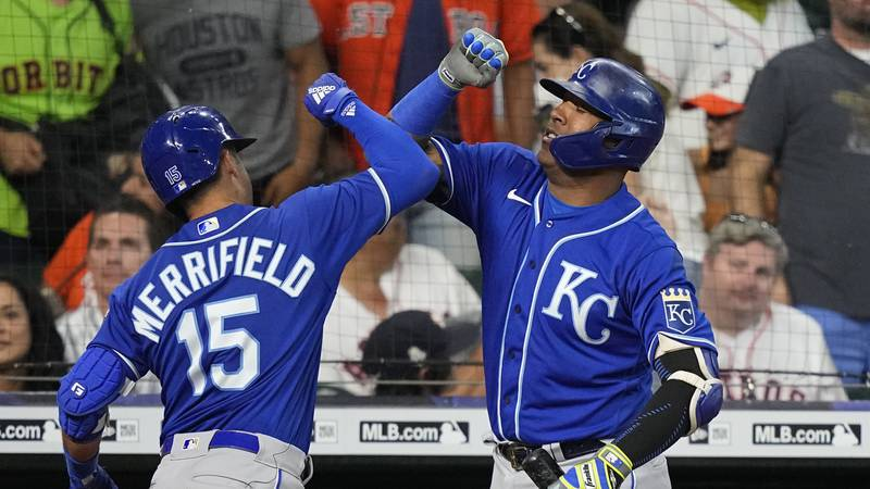 Kansas City Royals' Whit Merrifield (15) celebrates with Salvador Perez after hitting a grand...