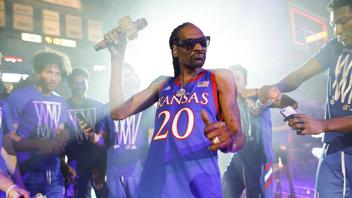 In this Friday, Oct. 4, 2019 photo, rapper Snoop Dogg performs for the Allen Fieldhouse crowd...