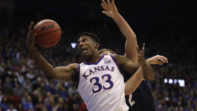 Kansas forward David McCormack (33) shoots while covered by Washburn forward Jonny Clausing,...