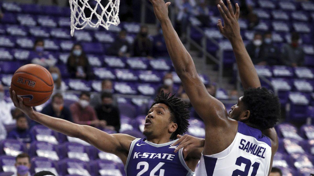 Kansas State guard Nijel Pack (24) shoots next to TCU center Kevin Samuel (21) during the...
