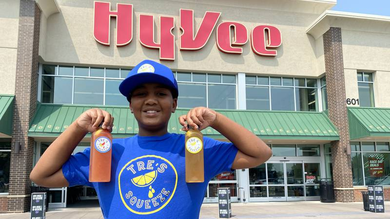 Tre Glasper, 9, poses in front of Hy-Vee in Manhattan after securing a deal to sell his...