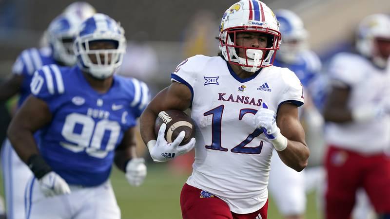 Kansas wide receiver Torry Locklin (12) runs for a touchdown as Duke defensive tackle DeWayne...