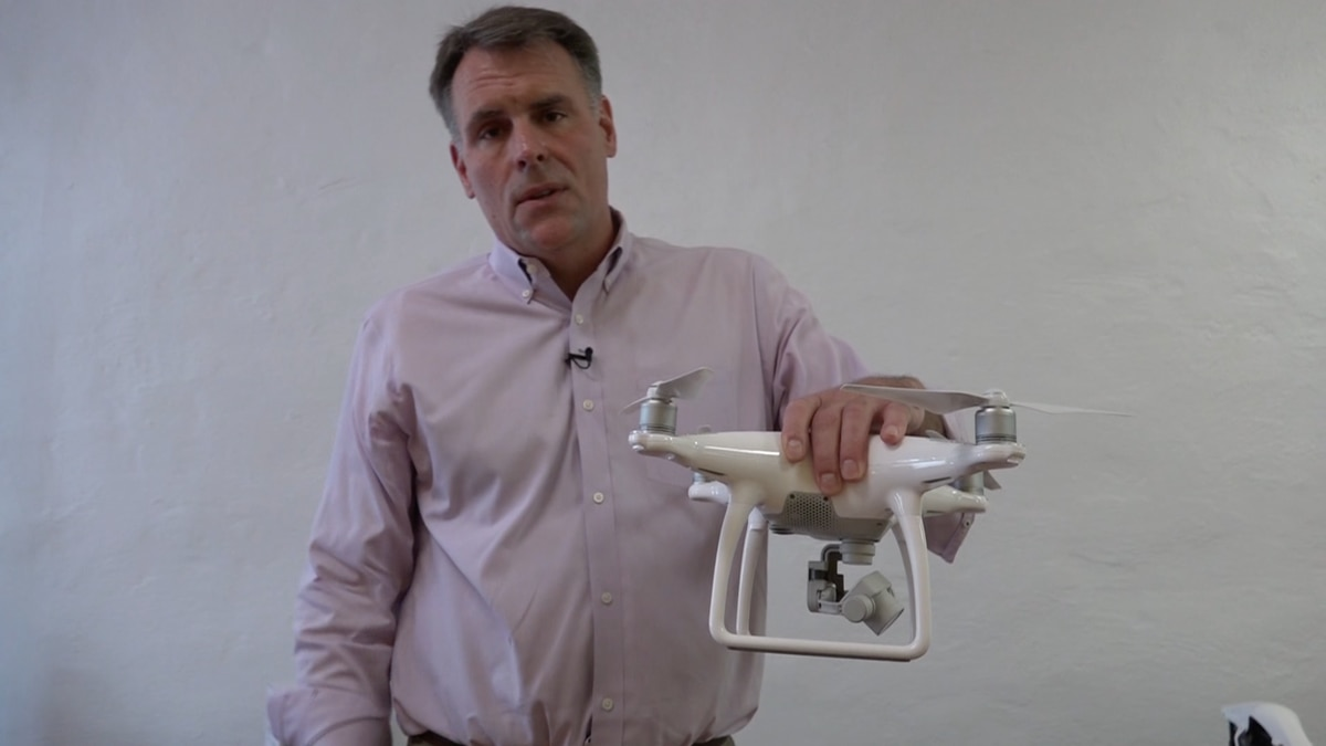 Eric Jones, the director of business development for Expert Drones, shows off the company's latest and greatest unmanned aircraft inside the new store in Alexandria on August 16, 2016.