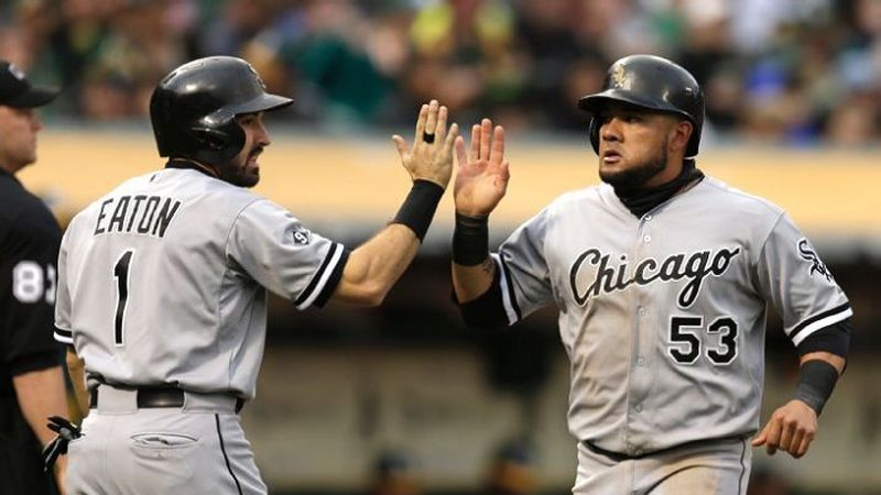 Chicago White Sox's Adam Eaton, left, and Melky Cabrera celebrate after scoring  (AP...