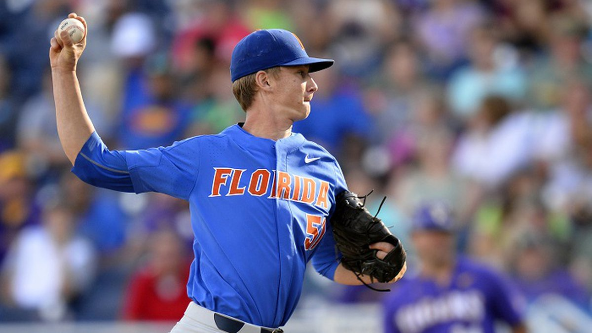FILE - In this June 26, 2017, file photo, Florida pitcher Brady Singer (51) throws in the first...