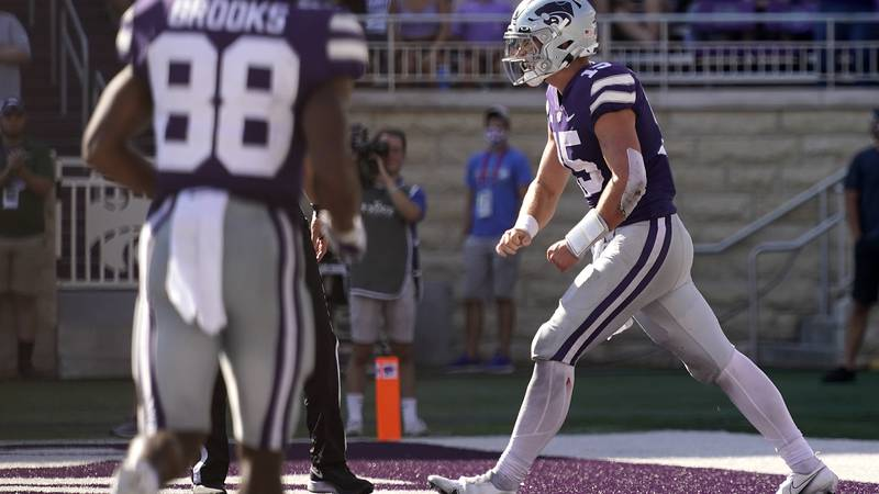 Kansas State quarterback Will Howard (15) celebrates after running for a touchdown during the...