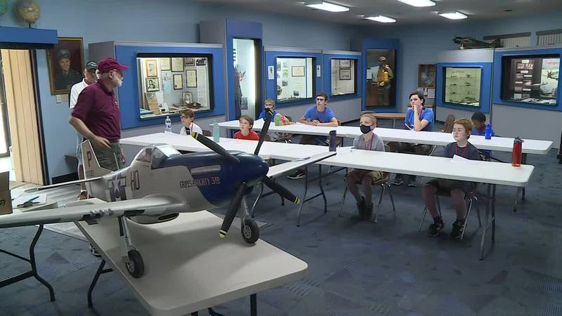 The kids are part of a class at the Combat Air Museum.
