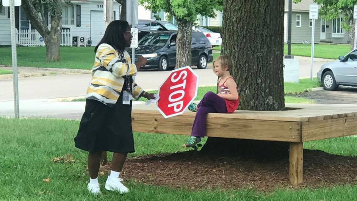 USD 501 Superintendent Dr. Tiffany Anderson serves as a school crossing guard on the first day of class, on August 13, 2019. (WIBW/Shawn Wheat)