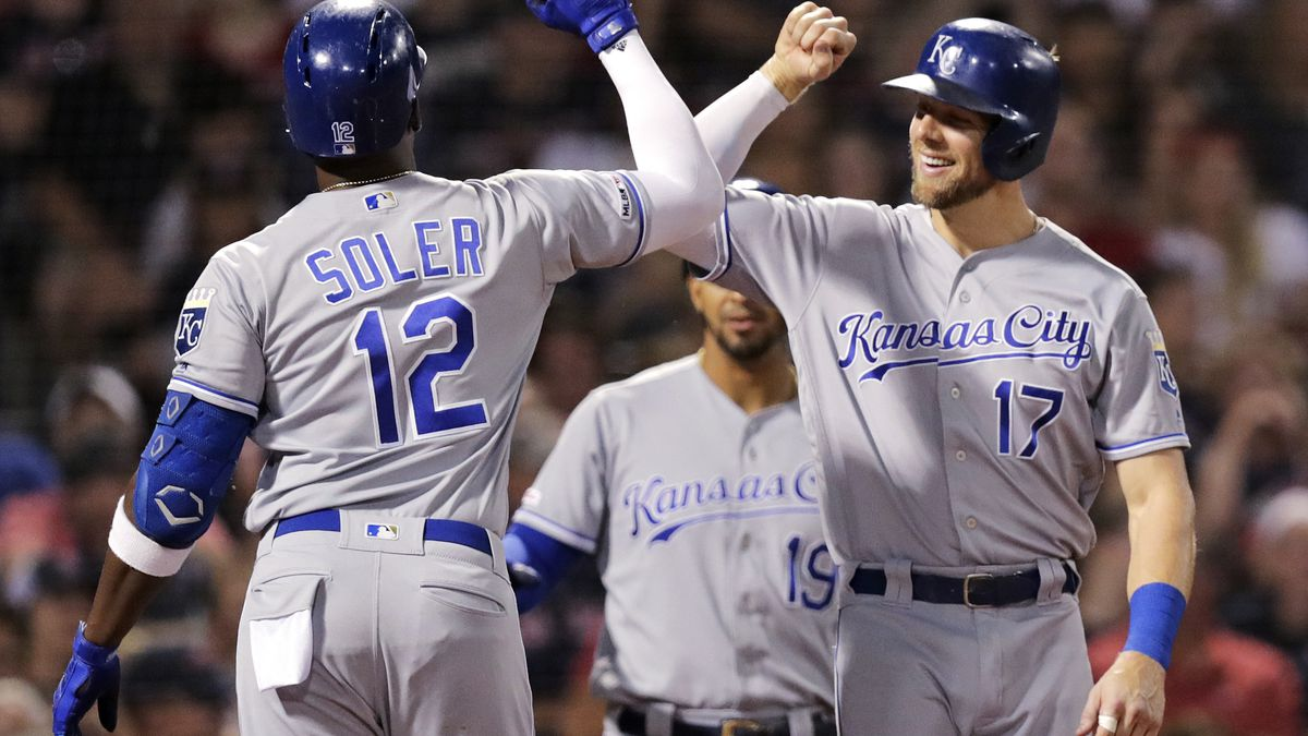 Kansas City Royals' Jorge Soler (12) is congratulated by Hunter Dozier (17) after his two run home run, his second of the night, during the fifth inning of a baseball game against the Boston Red Sox at Fenway Park in Boston, Tuesday, Aug. 6, 2019. (AP Photo/Charles Krupa)