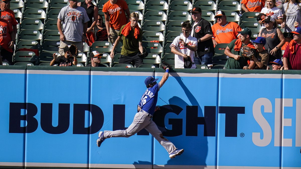 Kansas City Royals left fielder Andrew Benintendi makes a catch on a ball hit by Baltimore...