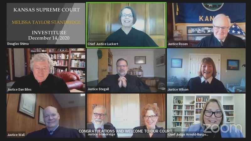 Melissa Taylor Standridge (bottom center) officially joined the Kansas Supreme Court Monday...