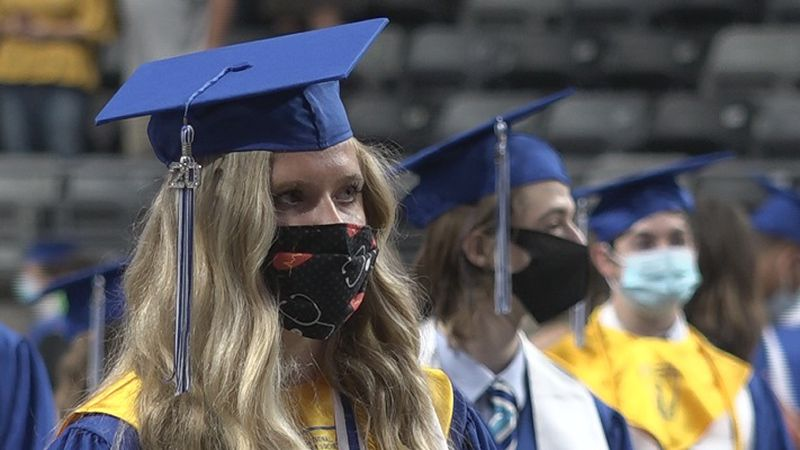 Washburn Rural High School seniors wear masks at their postponed commencement ceremony May 1,...