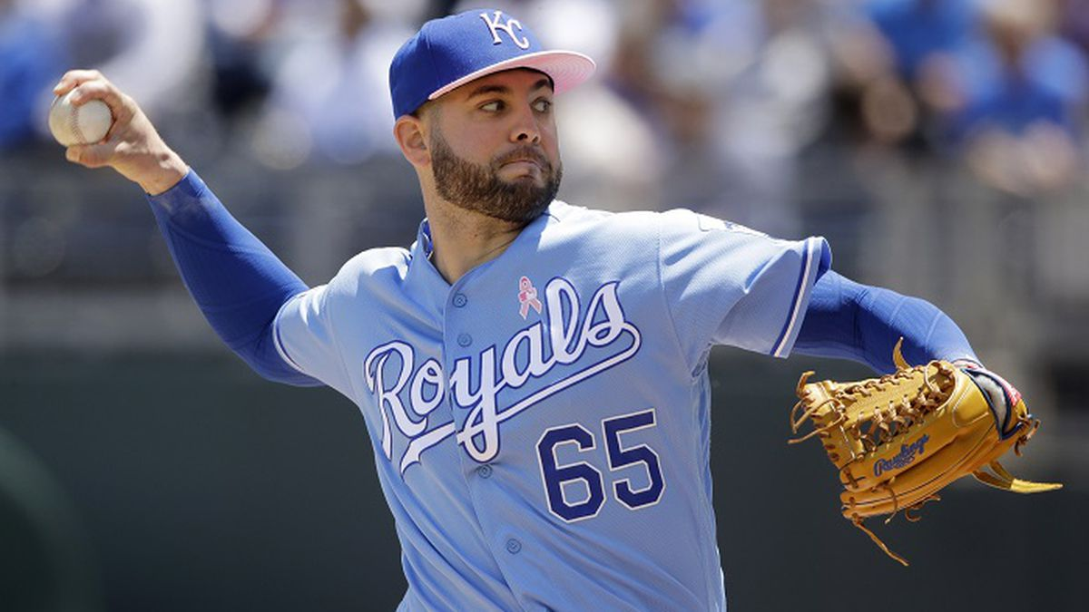 Kansas City Royals starting pitcher Jakob Junis throws during the first inning of a baseball game against the Philadelphia Phillies, Sunday, May 12, 2019, in Kansas City, Mo. (AP Photo/Charlie Riedel)