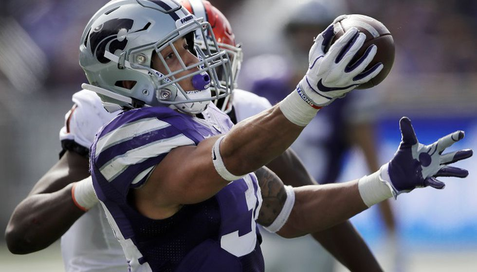 Barnes runs for 4 TDs as K-State routs Oklahoma State, 31-12