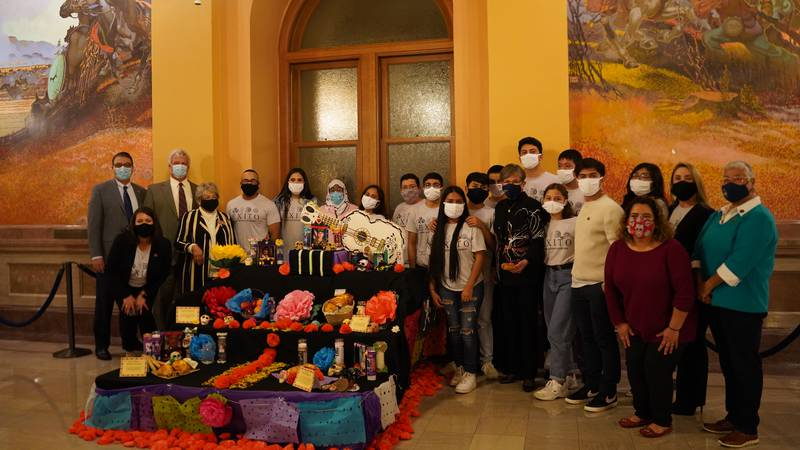 Students from Dodge City and Gov. Kelly unveil the Day of the Dead altar at the Kansas...