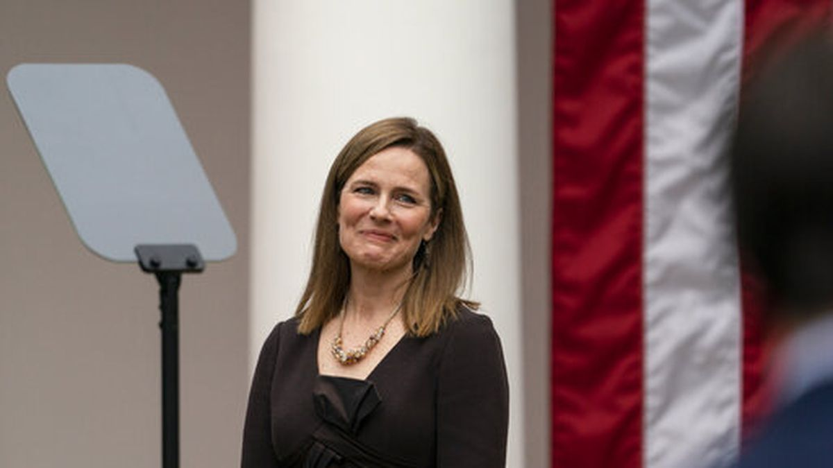 Judge Amy Coney Barrett smiles as President Donald Trump announces her as his nominee to the Supreme Court, in the Rose Garden at the White House, Saturday, Sept. 26, 2020, in Washington. (AP Photo/Alex Brandon)