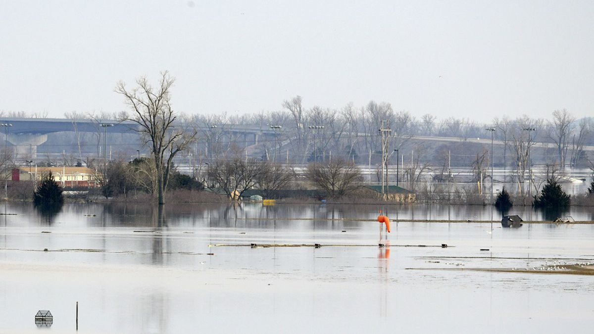 An orange windsock is seen at Offutt Air Force Base in Bellevue, Neb., site of the bases' flooded runway, Sunday, March 17, 2019. Rising waters from the Missouri River flooded about a third of the base, including about 3,000 feet of the base's 11,700-foot runway. (AP Photo/Nati Harnik)
