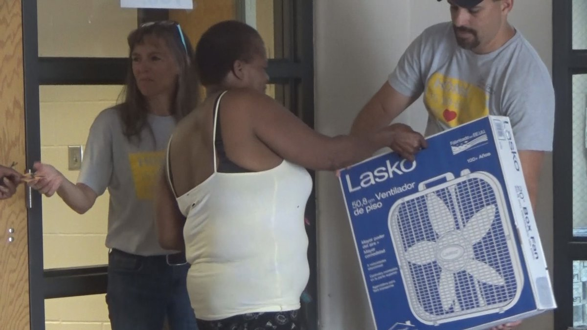 (File Photo/June 2018) Volunteers pass out free fans at the Topeka Salvation Army.