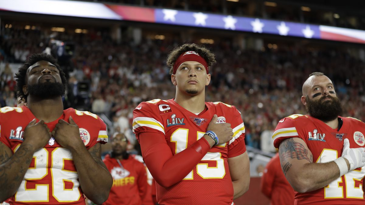 Kansas City Chiefs' Damien Williams (26), Patrick Mahomes (15), and Anthony Sherman (42) stand during the national anthem before the NFL Super Bowl 54 football game against the San Francisco 49ers Sunday, Feb. 2, 2020, in Miami Gardens, Fla.