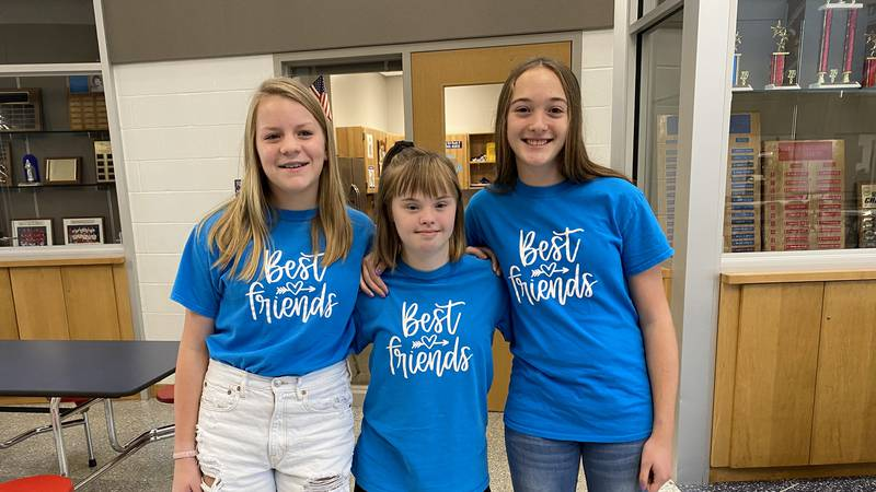 Best friends Tara, Claire, and Laina pose together at Seaman Middle School during Down Syndrome...