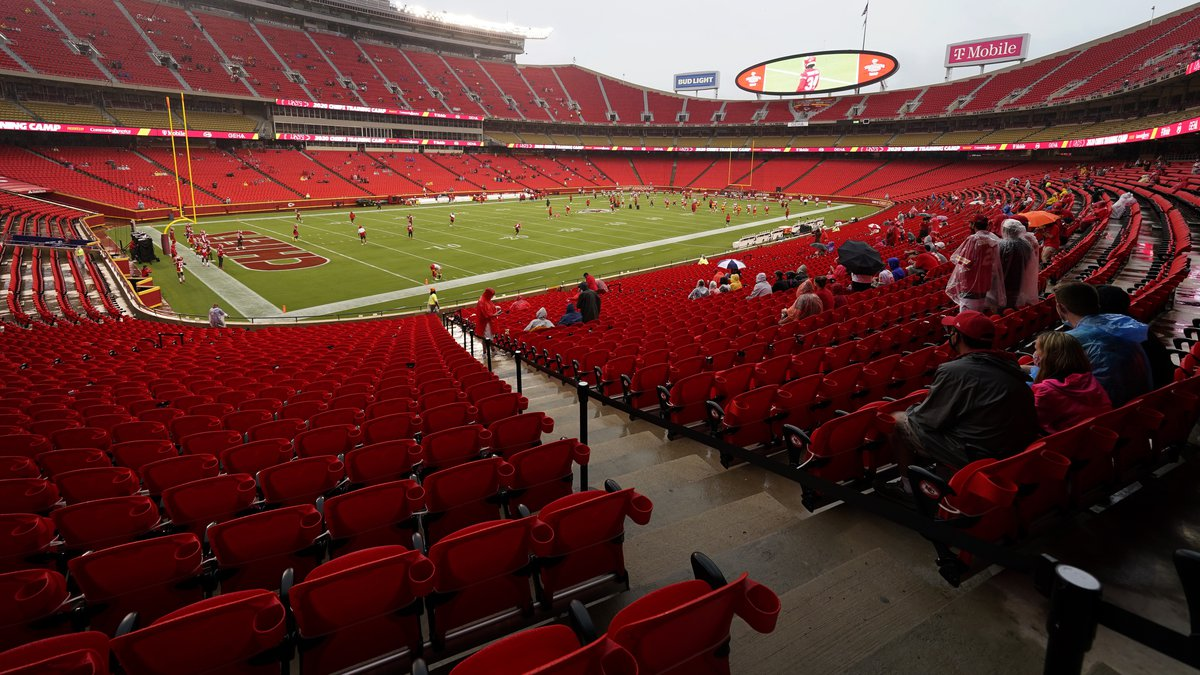 Fans watch the Kansas City Chiefs during NFL football training camp Saturday, Aug. 29, 2020, at...