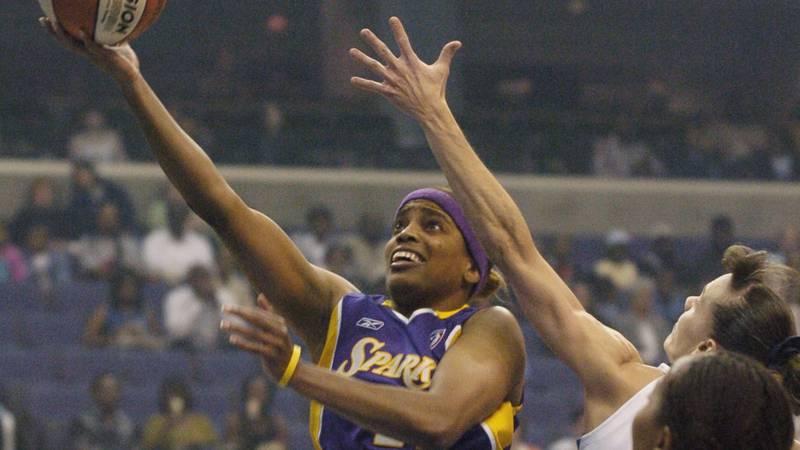 Los Angeles Sparks' Tamecka Dixon, left, goes to the basket against Washington Mystics' Coco...