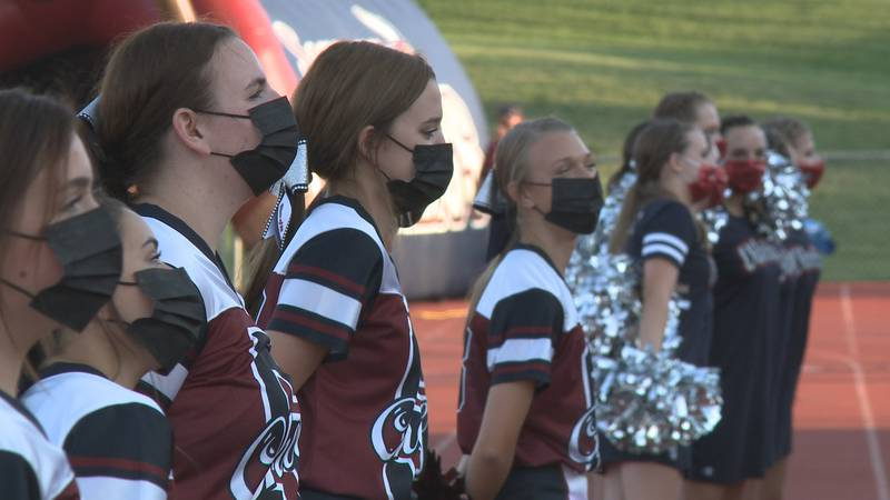 Masked cheerleaders at Seaman HS vs. Washburn Rural football game.