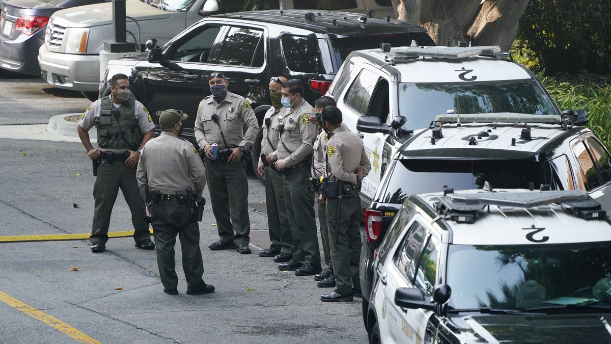 Police officers stand outside St. Francis Medical Center on Monday, Sept. 14, 2020, in Lynwood, Calif. Two Los Angeles County Sheriff's deputies were shot in an apparent ambush Saturday.