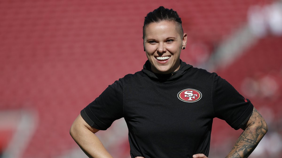 San Francisco 49ers offensive assistant Katie Sowers watches warms up before an NFL football...