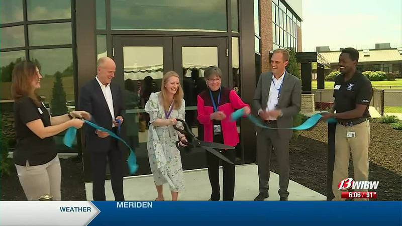 Officials cut the ribbon on Hills Pet Nutrition's Small Paws Innovation Center on Wednesday,...