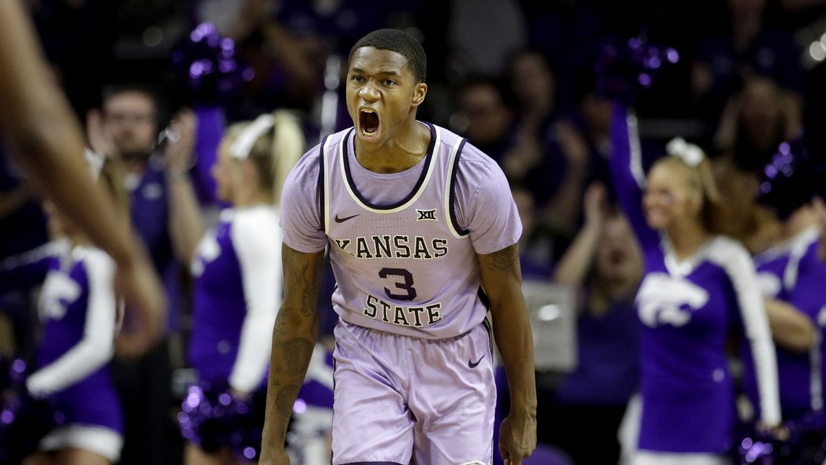 Kansas State's DaJuan Gordon celebrates after a teammate's basket during the first half of an NCAA college basketball game against West Virginia Saturday, Jan. 18, 2020, in Lawrence, Kan. (AP Photo/Charlie Riedel)