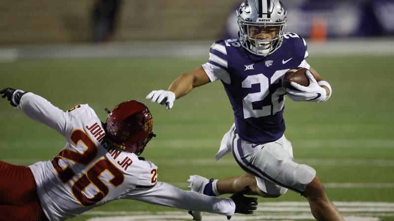 Kansas State running back Deuce Vaughn (22) gets past Iowa State defensive back Anthony Johnson...
