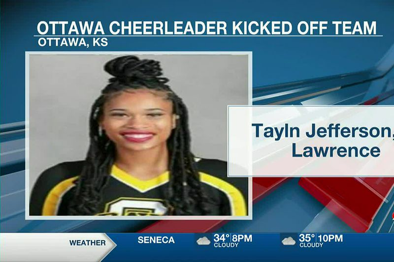 A Kansas cheerleader says she was kicked off the squad after her coach said her braids were too...