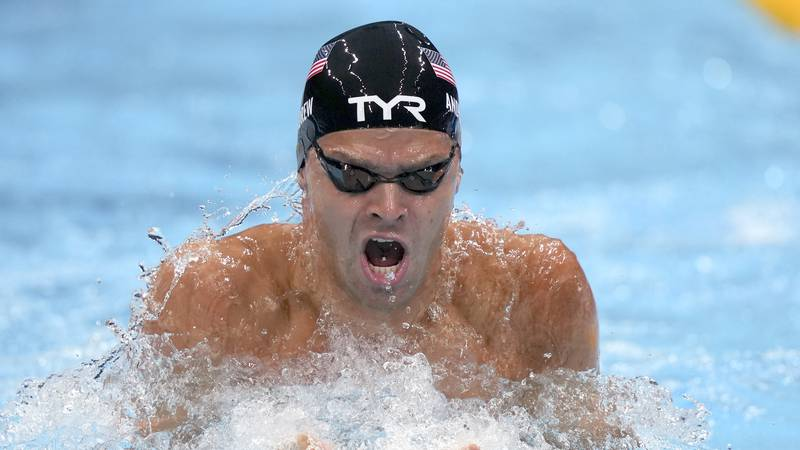 Michael Andrew, of the United States, swims during a semifinal in the men's 100-meter...