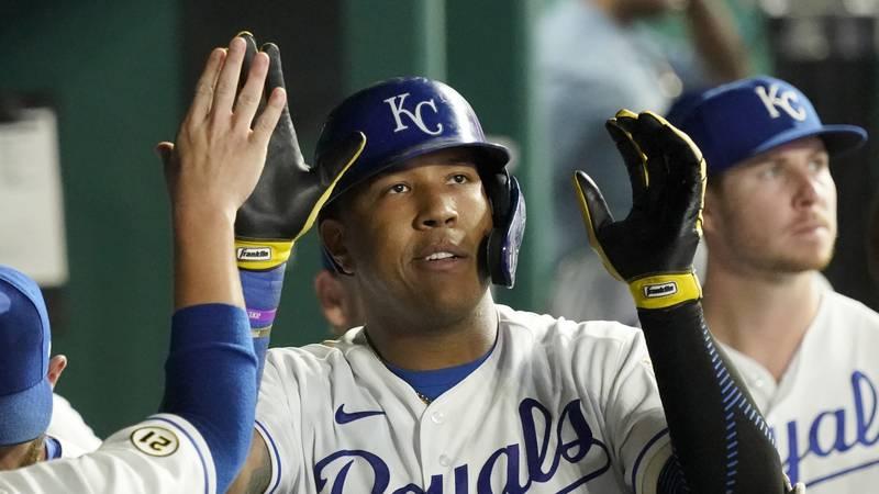 Kansas City Royals' Salvador Perez celebrates in the dugout after hitting a solo home run...