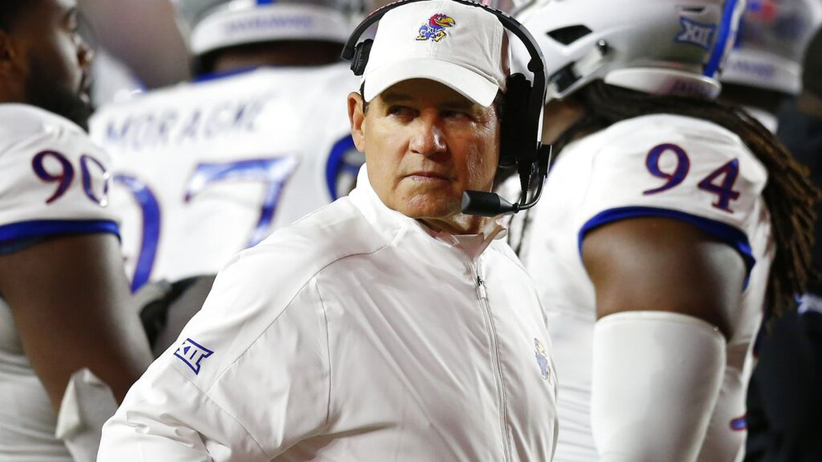 FILE - In this Sept. 13, 2019, file photo, Kansas coach Les Miles stands with his team during a timeout in the second half of an NCAA college football game against Boston College in Boston. Kansas plays Baylor this week in Baylor coach Dave Aranda's debut. (AP Photo/Michael Dwyer, File)