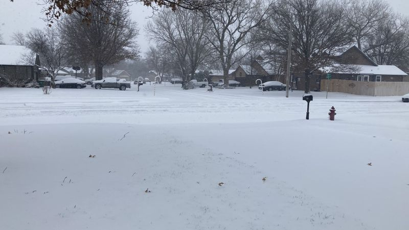 The Wichita area received more than 5 inches of snow on Friday morning, setting a New Year's...