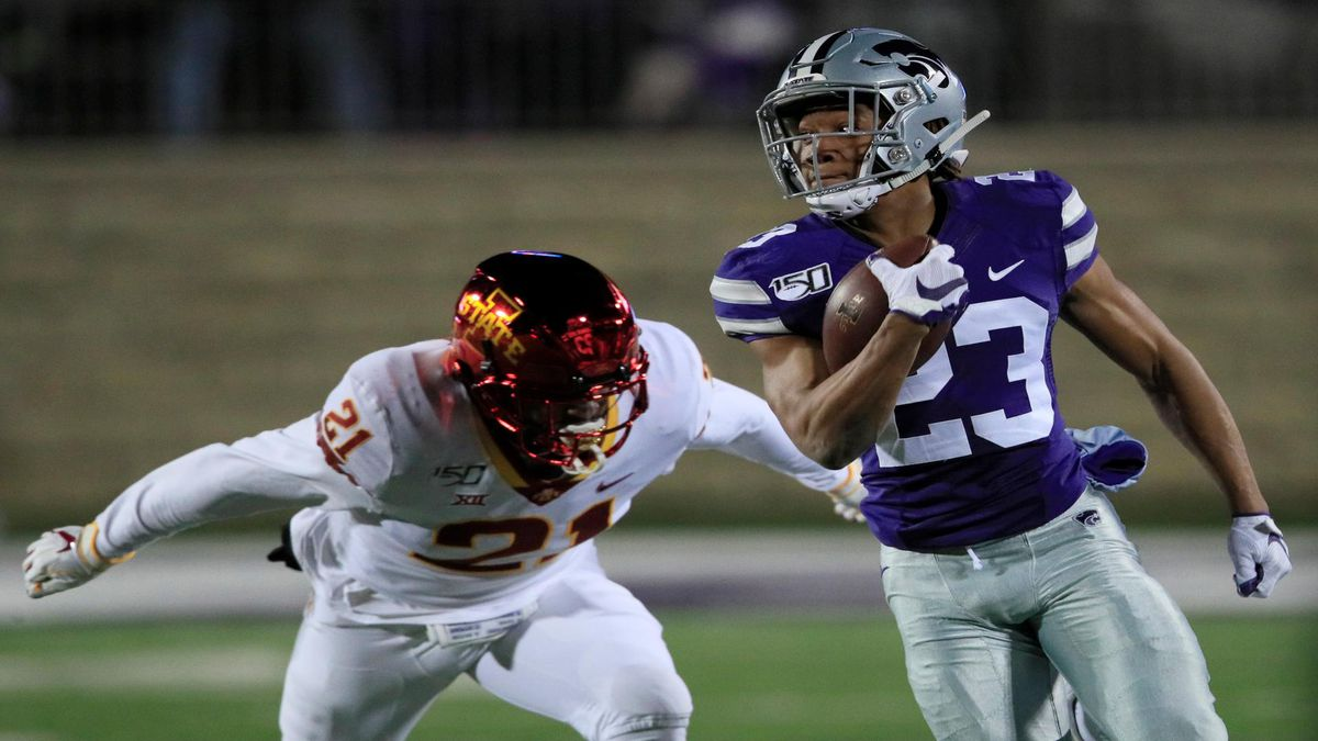 Kansas State returner Joshua Youngblood (23) gets past Iowa State linebacker Jatairis Grant (21) on a 93-yard touchdown return during the first half of an NCAA college football game in Manhattan, Kan., Saturday, Nov. 30, 2019. (AP Photo/Orlin Wagner)