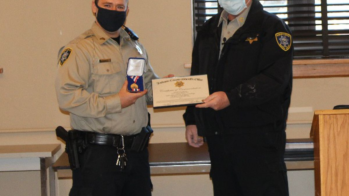 Sheriff Tim Morse awards Sgt. Spiker the Medal of Valor