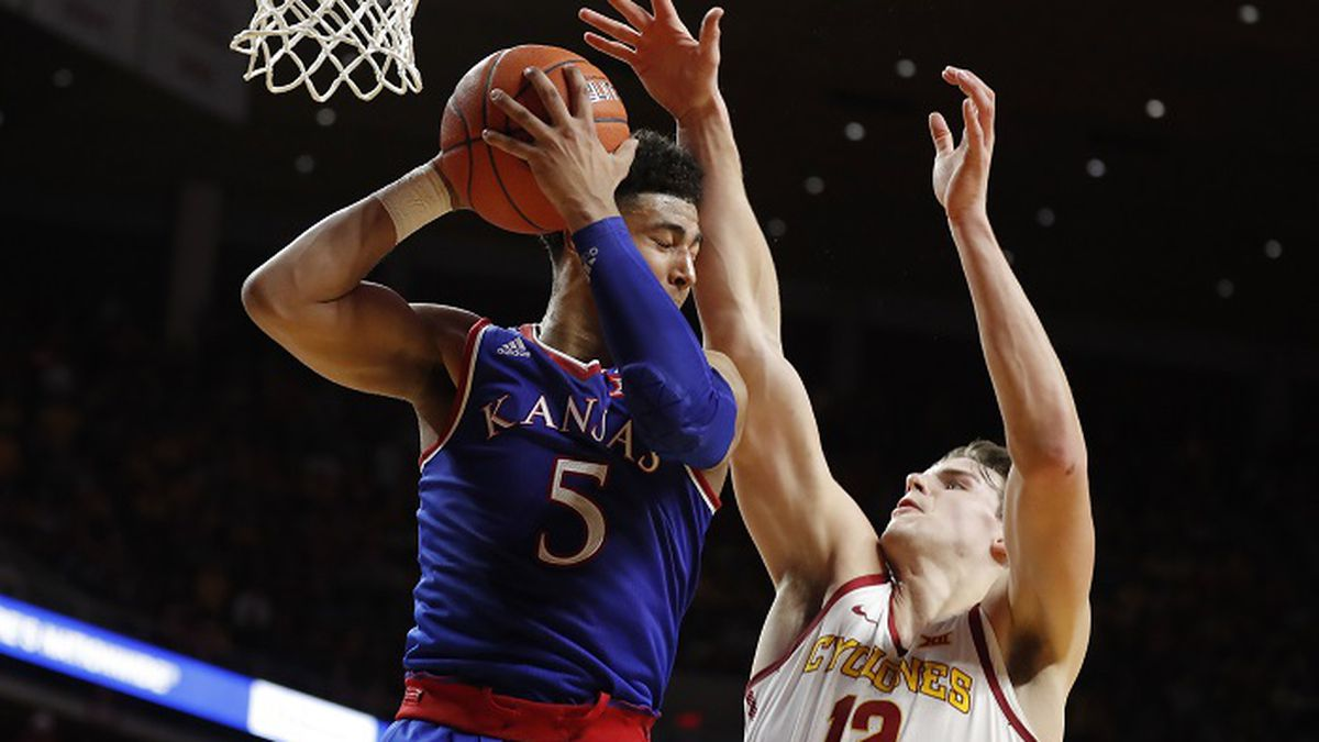 Kansas guard Quentin Grimes (5) grabs a rebound over Iowa State forward Michael Jacobson (12) during the first half of an NCAA college basketball game, Saturday, Jan. 5, 2019, in Ames, Iowa. (AP Photo/Charlie Neibergall)