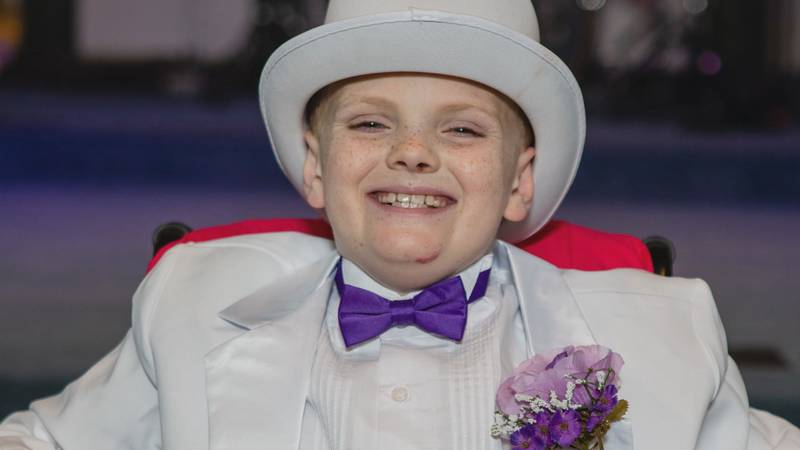 """Nathan Tuder, 11, celebrates his """"prom"""" and """"wedding"""" as he checks milestone items off his..."""